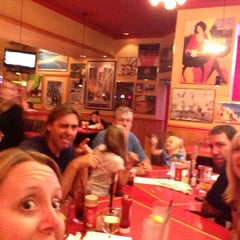 Photo taken at Red Robin Gourmet Burgers by Jenelle H. on 7/21/2013