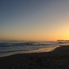 Photo taken at Isla Vista Beach by Mark V. on 4/14/2014