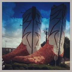 Photo taken at World's Largest Cowboy Boots by Kelley H. on 10/5/2013
