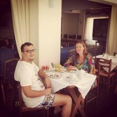 Photo taken at Aeolis Hotel by Tolga T. on 8/24/2014