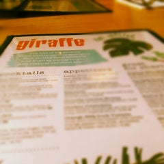 Photo taken at Giraffe by Leah C. on 12/29/2012