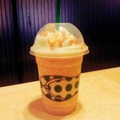 Photo taken at Starbucks by Manami on 9/12/2015