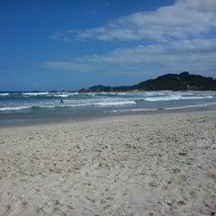 Photo taken at Praia da Ferrugem by Luciane P. on 2/4/2013
