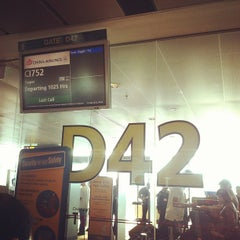 Photo taken at Gate D42 by Marcus L. on 4/15/2013