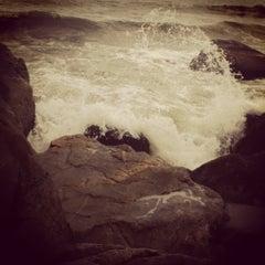 Photo taken at Praia de Itapoá by Thais A. on 12/30/2012