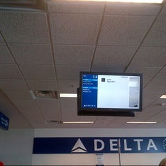 Photo taken at Gate C4 by Tom D. on 2/14/2013