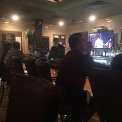 Photo taken at Jamie's Cigar Bar & Restaurant by Mike C. on 5/15/2015