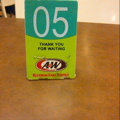 Photo taken at A&W by Made K. on 2/8/2014
