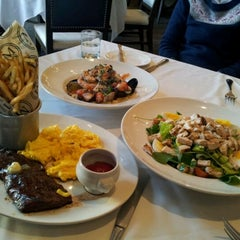 Photo taken at Morels French Steakhouse & Bistro by Monkey K. on 1/14/2012