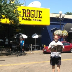Photo taken at Rogue Ales Public House & Brewery by Kari S. on 7/26/2013