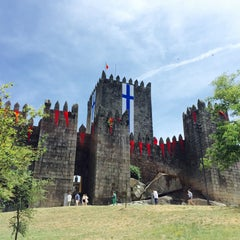 Photo taken at Muralhas da Cidade de Guimarães by Juan Carlos G. on 7/5/2015