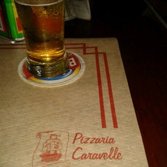 Photo taken at Caravelle Pizzaria by Monique S. on 1/23/2013