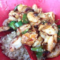 Photo taken at Genghis Grill by Stephanie S. on 5/9/2013