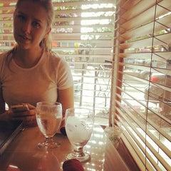 Photo taken at High Thai'd Café by Tyler V. on 6/29/2014