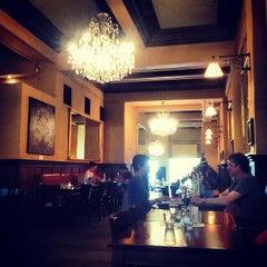 Photo taken at Pravda Café by Mary H. on 12/7/2012