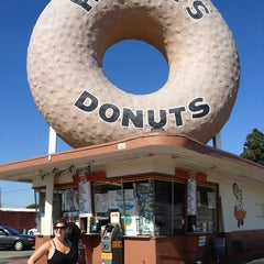 Photo taken at Randy's Donuts by Alix M. on 2/12/2013