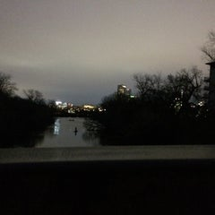Photo taken at Barton Springs Pedestrian Bridge by Melissa S. on 3/11/2015