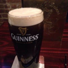 Photo taken at Lilly O'Brien's Bar & Restaurant by Tom S. on 3/17/2015