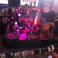 Photo taken at Flora-Bama Lounge, Package, and Oyster Bar by Tay Wrex R. on 5/5/2013