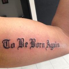Photo taken at Evolution Tattoo by Fernando I. on 5/18/2013