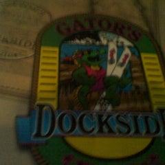 Photo taken at Gator's Dockside by Lisa. on 9/20/2012