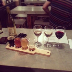 Photo taken at Buzz Wine Beer Shop by Nina K. on 5/2/2013