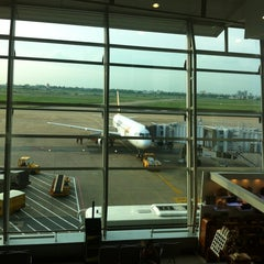 Photo taken at Tan Son Nhat International Airport (SGN) Sân Bay Quốc Tế Tân Sơn Nhất by Nat R. on 5/26/2013