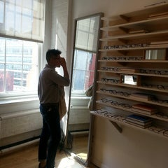 Photo taken at Warby Parker - Puck Store by Tracy W. on 7/7/2013
