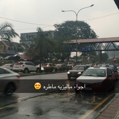 Photo taken at Carrefour Bus Stop by MooDi on 10/16/2015