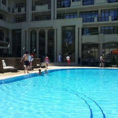 Photo taken at open air swimming pool @ Georgia Palace Hotel by Rahida H. on 6/13/2013