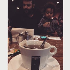 Photo taken at El Patio Argentine Café by Priscilla L. on 1/25/2015