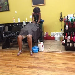 Photo taken at De Lux Natural Hair Gallery by Andrew L. on 7/14/2013