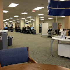 Photo taken at UTA Library by Devin G. on 3/30/2013