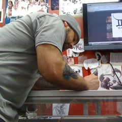 Photo taken at Whatever Tattoo by Danny L. on 1/16/2011