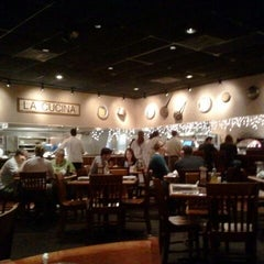 Photo taken at Carrabba's Italian Grill by Elizabeth P. on 12/11/2011