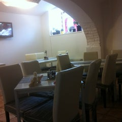Photo taken at ISHA café restaurant by Dita on 12/17/2011