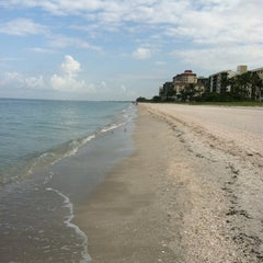 Photo taken at Vanderbilt Beach by Nicole P. on 7/28/2012