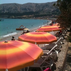 Photo taken at Baška Beach by Di . on 6/7/2012