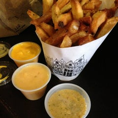 Photo taken at Pommes Frites by Bao T. on 7/7/2013