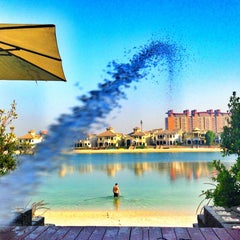 Photo taken at Palm Jumeirah Frond C by Roman B. on 10/7/2013