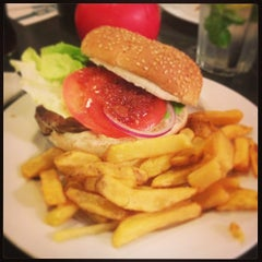 Photo taken at Gourmet Burger Kitchen by Raymond M. on 7/4/2013