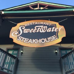 Photo taken at Sweetwater Steakhouse by Reuben R. on 7/16/2015