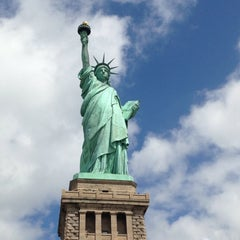 Photo taken at Statue of Liberty by Lupita R. on 7/4/2013