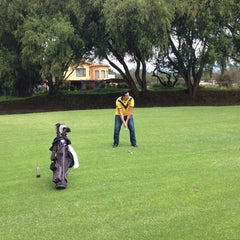 Photo taken at Arrayanes Country Club by Marcelo B. on 3/3/2014