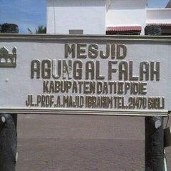 Photo taken at Masjid Agung Al-Falah by Kenyol K. on 8/6/2013