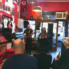 Photo taken at Pure Pop Records by Carlee P. on 8/18/2013