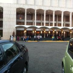 Photo taken at Gran Teatro del Cibao by Marcos D. on 4/21/2013