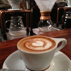 Photo taken at Intelligentsia Coffee by Mo N. on 12/15/2012