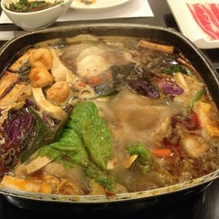 Photo taken at 新辣道鱼火锅 | New Spicy Way by Lisa C. on 1/19/2013