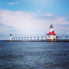 Photo taken at St. Joseph North Pier (at Tiscornia Park) by Michael F. on 6/8/2014